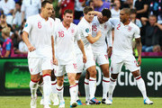 Joleon Lescott of England celebrates scoring with Glen Johnson  and Steven Gerrard of England during the UEFA EURO 2012 group D match between France and England at Donbass Arena on June 11, 2012 in Donetsk, Ukraine.
