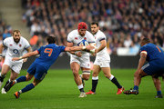 James Haskell of England is tackled by Maxime Machenaud of France during the NatWest Six Nations match between France and England at Stade de France on March 10, 2018 in Paris, France.