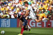 Thomas Mueller of Germany and Patrice Evra of France clash during the 2014 FIFA World Cup Brazil Quarter Final match between France and Germany at Maracana on July 4, 2014 in Rio de Janeiro, Brazil.