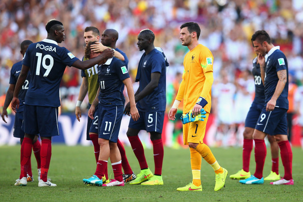 Paul Pogba (L) consoles Antoine Griezmann of France as goalkeeper Hugo Lloris looks on during the 2014 FIFA World Cup Brazil Quarter Final match between France and Germany at Maracana on July 4, 2014 in Rio de Janeiro, Brazil.