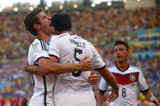 Mats Hummels of Germany (C) celebrates scoring his team's first goal with Thomas Mueller (L) and Mesut Oezil during the 2014 FIFA World Cup Brazil Quarter Final match between France and Germany at Maracana on July 4, 2014 in Rio de Janeiro, Brazil.