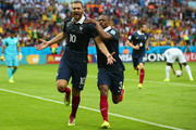 Karim Benzema of France celebrates scoring his team's first goal on a penalty kick with Patrice Evra during the 2014 FIFA World Cup Brazil Group E match between France and Honduras at Estadio Beira-Rio on June 15, 2014 in Porto Alegre, Brazil.