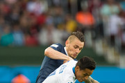 Mathieu Debuchy of France fights off Andy Najar of Honduras during the 2014 FIFA World Cup Brazil Group E match between France and Honduras at Estadio Beira-Rio on June 15, 2014 in Porto Alegre, Brazil.