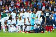 Wilson Palacios of Honduras (ground L) and Paul Pogba of France (ground R) lie on the field after a challenge during the 2014 FIFA World Cup Brazil Group E match between France and Honduras at Estadio Beira-Rio on June 15, 2014 in Porto Alegre, Brazil.