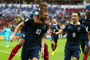 Karim Benzema of France celebrates scoring the first goal with Patrice Evra, Mathieu Valbuena during the 2014 FIFA World Cup Brazil Group E match between France and Honduras at Estadio Beira-Rio on June 15, 2014 in Porto Alegre, Brazil.