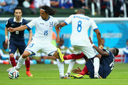 Roger Espinoza of Honduras controls the ball as teammate Wilson Palacios battles with Paul Pogba of France during the 2014 FIFA World Cup Brazil Group E match between France and Honduras at Estadio Beira-Rio on June 15, 2014 in Porto Alegre, Brazil.