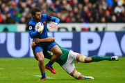 Maxime Medard of France is tackled Mike McCarthy of Ireland during the RBS Six Nations match between France and Ireland at the Stade de France on February 13, 2016 in Paris, France.