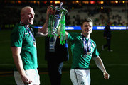 Brian O'Driscoll of Ireland and captain Paul O'Connell (L) of Ireland celebrate with the trophy after winning the six nations championship with a 22-20 victory over France during the RBS Six Nations match between France and Ireland at Stade de France on March 15, 2014 in Paris, France.