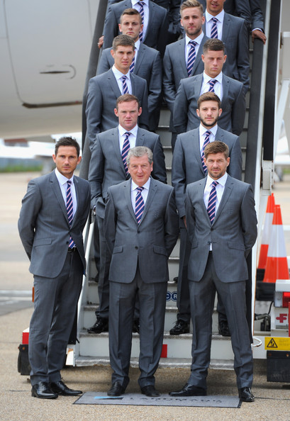The England Team Depart for the 2014 Brazil World Cup [suit,white-collar worker,event,formal wear,businessperson,management,team,tuxedo,official,ceremony,roy hodgson,steven gerrard,luke shaw,handout image,left-right,plane,england,england team depart,fa,brazil world cup]