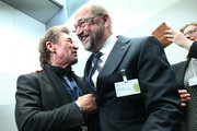 Martin Schulz (C), chancellor candidate of the German Social Democrats (SPD) in German federal elections scheduled for September, chats with German rock singer Peter Maffay (L) at a meeting of the SPD Bundestag faction prior to the election of the new president of Germany by the Federal Assembly at the Reichstag on February 12, 2017 in Berlin, Germany. Frank-Walter Steinmeier, a German Social Democrat (SPD), is Germany's former foreign minister and is likely to win. He will succeed outgoing German president Joachim Gauck.