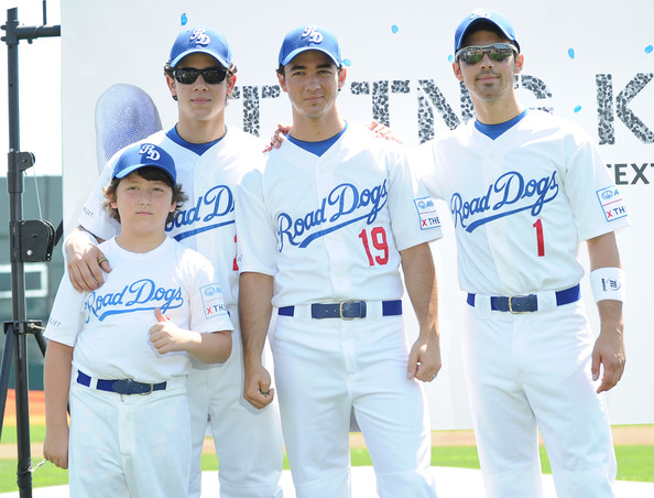 Jonas Brothers Encourage Fans to X the TXT on Road Dogs Softball Tour
