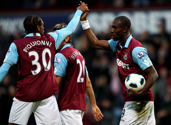 Frederic Piquionne Frederic Piquionne of West Ham congratulates team mate Carlton Cole on scoring the opening goal during the Barclays Premier League match between West Ham United and Newcastle United at The Boleyn Ground on October 23, 2010 in London, England.