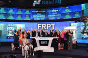 Richard Thompson (C), Chief Executive Officer of Freshpet, Inc., Freshpet management and guest ring the Opening Bell at NASDAQ MarketSite on November 7, 2014 in New York City.