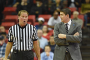 Referee John Higgins (L) talks with head coach Dave Rice of the UNLV Rebels during their game against the Fresno State Bulldogs at the Thomas & Mack Center on February 10, 2015 in Las Vegas, Nevada. UNLV won 73-61.