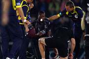 Kieron Pollard of Somerset has to retire hurt after the ball got through his helmet and face guard from a Dominic Cork delivery during the Friends Provident T20 Final between Hampshire Royals and Somerset at The Rose Bowl on August 14, 2010 in Southampton, England.