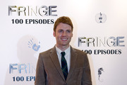 """Seth Gabel poses for photos on the red carpet while attending """"Fringe"""" celebrates 100 episodes and final season at Fairmont Pacific Rim on December 1, 2012 in Vancouver, Canada."""