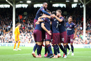 Aaron Ramsey of Arsenal celebrates with teammates after scoring his team's third goal during the Premier League match between Fulham FC and Arsenal FC at Craven Cottage on October 7, 2018 in London, United Kingdom.