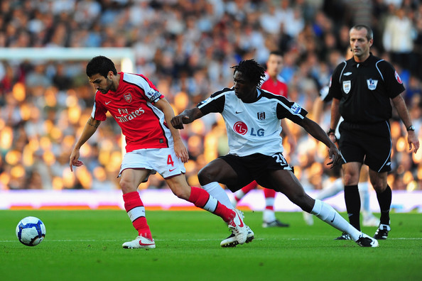 Dickson Etuhu of Fulham chases Cesc Fabregas of Arsenal during the Barclays Premier League match between Fulham and Arsenal at Craven Cottage on September 26, 2009 in London, England.