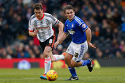Jay Tabb of Ipswich Town (R) is pursued by Fulham captain Scott Parker during the Sky Bet Championship match between Fulham and Ipswich Town at Craven Cottage on February 14, 2015 in London, England.