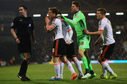 Scott Parker of Fulham (8) leads the protests to referee Chris Kavanagh as Kostas Stafylidis of Fulham (not pictured) is sent off by  during the Sky Bet Championship match between Fulham and Leeds United at Craven Cottage on March 18, 2015 in London, England.