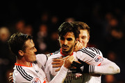 Bryan Ruiz (R) of Fulham celebrates with team mate Scott Parker after scoring the winning goal during the Sky Bet Championship match between Fulham and Reading at Craven Cottage on January 17, 2015 in London, England.