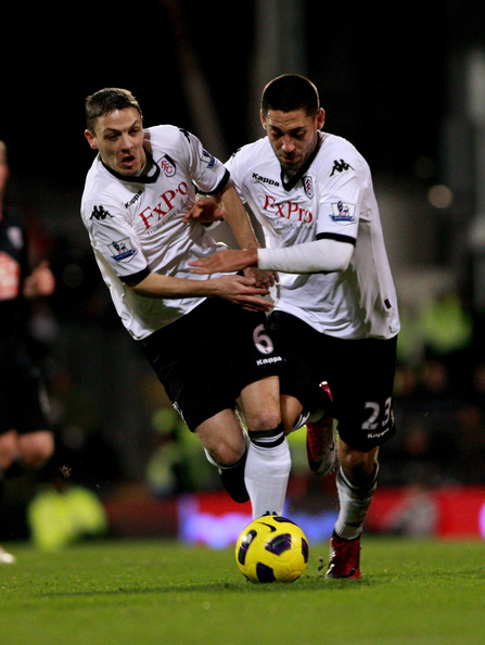 Chris Baird (L) of Fulham tangles with teammate Clint Dempsey during the Barclays Premier League match between Fulham and West Bromwich Albion at Craven Cottage on January 4, 2011 in London, England.
