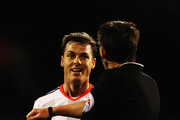 Fulham captain Scott Parker talks to match referee Lee Probert during the FA Cup Third Round match between Fulham and Wolverhampton Wanderers at Craven Cottage on January 3, 2015 in London, England.