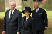"""Prince Charles, Prince of Wales follows the Duke and Duchess of Devonshire during the funeral of Deborah, Dowager Duchess of Devonshire at St Peters Church, Edensor on October 2, 2014 in Chatsworth, England. Deborah Cavendish, Dowager Duchess Of Devonshire, the last surviving Mitford sister, died aged 94 on September 24, 2014. Deborah was known as the """"housewife duchess"""", and her noted business acumen made Chatsworth House one of the most successful and profitable stately homes in England."""