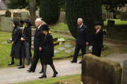 """Prince Charles, Prince of Wales and Camilla,Duchess of Cornwall follow the Duke and Duchess of Devonshire, Lady Sophia Cavendish and Lady Emma Cavendish (L) during the funeral of Deborah, Dowager Duchess of Devonshire at St Peters Church, Edensor on October 2, 2014 in Chatsworth, England. Deborah Cavendish, Dowager Duchess Of Devonshire, the last surviving Mitford sister, died aged 94 on September 24, 2014. Deborah was known as the """"housewife duchess"""", and her noted business acumen made Chatsworth House one of the most successful and profitable stately homes in England."""