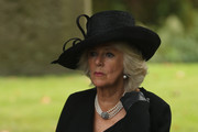 """Camilla, The Duchess of Cornwall, attends the funeral of Deborah, Dowager Duchess of Devonshire at St Peters Church, Edensor, on October 2, 2014 in Chatsworth, England. Deborah Cavendish, Dowager Duchess Of Devonshire, the last surviving Mitford sister, died aged 94 on September 24, 2014. Deborah was known as the """"housewife duchess"""", and her noted business acumen made Chatsworth House one of the most successful and profitable stately homes in England."""