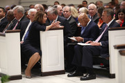 House Speaker Nancy Pelosi talks to former House Speaker John Boehner and Rep. John Lewis (D-GA) before a funeral service for former Rep. John Dingell on February 14, 2019 at Holy Trinity Catholic Church in Washington, DC. Dingell, who represented southeast Michigan for 59 years in the House of Representatives, died last week at age 92.