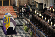 The Duke of Edinburgh's coffin, covered with His Royal Highness's Personal Standard is displayed in St George's Chapel as Queen Elizabeth II and Prince Andrew, Duke of York (R) watch during the funeral of Prince Philip, Duke of Edinburgh at Windsor Castle on April 17, 2021 in Windsor, United Kingdom. Prince Philip of Greece and Denmark was born 10 June 1921, in Greece. He served in the British Royal Navy and fought in WWII. He married the then Princess Elizabeth on 20 November 1947 and was created Duke of Edinburgh, Earl of Merioneth, and Baron Greenwich by King VI. He served as Prince Consort to Queen Elizabeth II until his death on April 9 2021, months short of his 100th birthday. His funeral takes place today at Windsor Castle with only 30 guests invited due to Coronavirus pandemic restrictions.