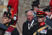 Prince Charles, Prince of Wales walks in the Ceremonial procession to St George's Chapel during the funeral of Prince Philip, Duke of Edinburgh, at Windsor Castle on April 17, 2021 in Windsor, England. Prince Philip of Greece and Denmark was born 10 June 1921, in Greece. He served in the British Royal Navy and fought in WWII. He married the then Princess Elizabeth on 20 November 1947 and was created Duke of Edinburgh, Earl of Merioneth, and Baron Greenwich by King VI. He served as Prince Consort to Queen Elizabeth II until his death on April 9 2021, months short of his 100th birthday. His funeral takes place today at Windsor Castle with only 30 guests invited due to Coronavirus pandemic restrictions.