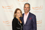 Katie Couric and John Molner on the red carpet of A Funny Thing Happened On The Way To Cure Parkinson's benefitting The Michael J. Fox Foundation at the Hilton New York on November 10, 2018.