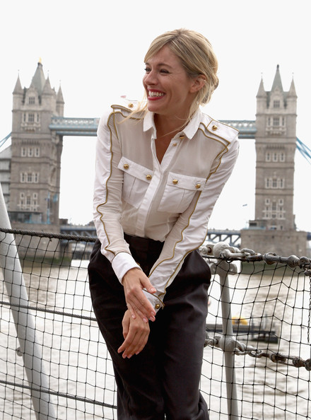 Actress Sienna Miller  poses for a photograph with wet trousers on HMS Belfast after arriving on a Royal Marine RIB during a photocall to launch 'G.I JOE: The Rise of Cobra' on July 22, 2009 in London, England.