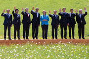 (From L to R) President of the European Council Donald Tusk, Japanese Prime Minister Shinzo Abe, Canadian President Stephen Harper, U.S. President Barack Obama, German Chancellor Angela Merkel, French President Francois Hollande, British Prime Minister David Cameron, Italian Prime Minister Matteo Renzi and President of the European Commission Jean-Claude Juncker pose at the group photo at the summit of G7 nations at Schloss Elmau on June 7, 2015 near Garmisch-Partenkirchen, Germany. In the course of the two-day summit G7 leaders are scheduled to discuss global economic and security issues, as well as pressing global health-related issues, including antibiotics-resistant bacteria and Ebola. Several thousand protesters have announced they will seek to march towards Schloss Elmau and at least 17,000 police are on hand to provide security.