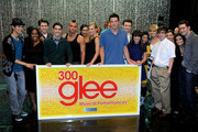 """The cast of GLEE poses with a large plaque listing all 300 songs they've performed at the """"GLEE"""" 300th musical performance special taping at Paramount Studios on October 26, 2011 in Los Angeles, California."""