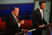 Presidential candidate Mike Huckabee (L) speaks while Louisiana Gov. Bobby Jindal looks on during the Republican Presidential Debate sponsored by Fox Business and the Wall Street Journal at the Milwaukee Theatre November 10, 2015 in Milwaukee, Wisconsin. The fourth Republican debate is held in two parts, one main debate for the top eight candidates, and another for four other candidates lower in the current polls.