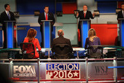 Presidential candidate Mike Huckabee (2nd R) speaks while Rick Santorum (L-R), New Jersey Governor Chris Christie, and Louisiana Governor Bobby Jindal look on during the Republican Presidential Debate sponsored by Fox Business and the Wall Street Journal at the Milwaukee Theatre November 10, 2015 in Milwaukee, Wisconsin. The fourth Republican debate is held in two parts, one main debate for the top eight candidates, and another for four other candidates lower in the current polls.