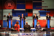 Presidential candidates Rick Santorum (L-R) speaks while New Jersey Governor Chris Christie, Mike Huckabee, and Louisiana Governor Bobby Jindal take part in the Republican Presidential Debate sponsored by Fox Business and the Wall Street Journal at the Milwaukee Theatre November 10, 2015 in Milwaukee, Wisconsin. The fourth Republican debate is held in two parts, one main debate for the top eight candidates, and another for four other candidates lower in the current polls.