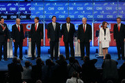 Republican presidential candidates (L-R) Rick Santorum, Rep. Ron Paul, Texas Gov. Rick Perry, Mitt Romney, Herman Cain, Newt Gingrich, Rep. Michele Bachmann, and Jon Huntsman are introduced prior to a debate at Constitution Hall November 22, 2011 in Washington, DC. The debate, hosted by CNN and in partnership with the Heritage Foundation and the American Enterprise Institute, was expected to focus primarily on national security, foreign policy and the economy.