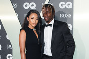 (L-R) Paige Bannister and Wilfried Zaha attend the GQ Men Of The Year Awards 2019 at Tate Modern on September 03, 2019 in London, England.