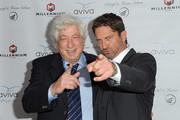 Producer Avi Lerner (L) and actor Gerard Butler (R) attend A Gala To Honor Avi Lerner And Millennium Films in Beverly Hills, California, on April 16, 2016. / AFP / ANGELA WEISS