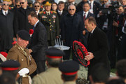 New Zealand Prime Minister John Key (L) and Australian Prime Minister Tony Abbott lay wreaths during the Commonwealth and Irish Memorial Service at Cape Helles on April 24, 2015 in Seddulbahir, Turkey. Turkish and Allied powers representatives, as well as family members of those who served, are commemorating the 100th anniversary of the Gallipoli campaign with ceremonies at memorials across the Gallipoli Peninsula. The Gallipoli land campaign, in which a combined Allied force of British, French, Australian, New Zealand and Indian troops sought to occupy the Gallipoli Peninsula and the strategic Dardanelles Strait during World War I, began on April 25, 1915 against Turkish forces of the Ottoman Empire. The Allies, unable to advance more than a few kilometers, withdrew after eight months. The campaign cost the Allies approximately 50,000 killed and up to 200,000 wounded, the Ottomans approximately 85,000 killed and 160,000 wounded.