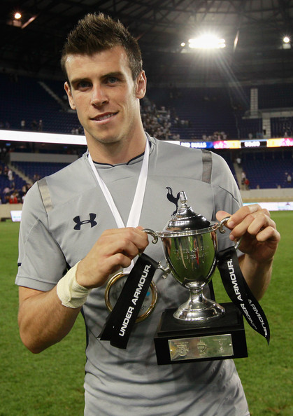 Gareth Bale Gareth Bale #9 of Tottenham Hotspur poses for a photo with the Under Armour Man of the Match Trophy after defeating the New York Red Bulls at Red Bull Arena on July 31, 2012 in Harrison, New Jersey.