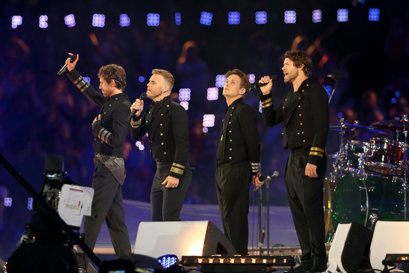 Gary Barlow Jason Orange, Gary Barlow, Mark Owen and Howard Donald of Take That perform during the Closing Ceremony on Day 16 of the London 2012 Olympic Games at Olympic Stadium on August 12, 2012 in London, England.