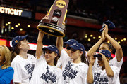 Breanna Stewart #30, Caroline Doty #5 and Kelly Faris #34 of the Connecticut Huskies hold up the National Championship Trophy with their teammates after defeating the Louisville Cardinals during the 2013 NCAA Women's Final Four Championship at New Orleans Arena on April 9, 2013 in New Orleans, Louisiana.