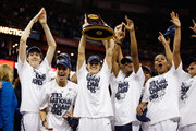 Kelly Faris #34 of the Connecticut Huskies (C) holds up the National Championship Trophy with her teammates after defeating the Louisville Cardinals during the 2013 NCAA Women's Final Four Championship at New Orleans Arena on April 9, 2013 in New Orleans, Louisiana.