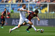 Giuseppe Rossi (R) of Genoa CFC is tackled by Milan Badelj of ACF Fiorentina during the serie A match between Genoa CFC and ACF Fiorentina at Stadio Luigi Ferraris on May 6, 2018 in Genoa, Italy.