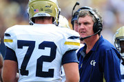 Head Coach Paul Johnson of the Georgia Tech Yellow Jackets discusses a play with Chris Griffin #72 during the game against the Georgia Southern Eagles at Bobby Dodd Stadium on September 13, 2014 in Atlanta, Georgia.